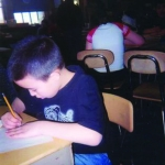 Figure C Me helping other kids to do their work. Jeffrey, age 10